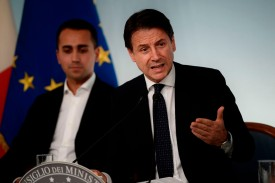 Italian Prime Minister Giuseppe Conte, right, speaks at a press conference following a cabinet meeting on the country's draft budget on Oct. 15. (Photo by Filippo Monteforte/AFP/Getty Images)