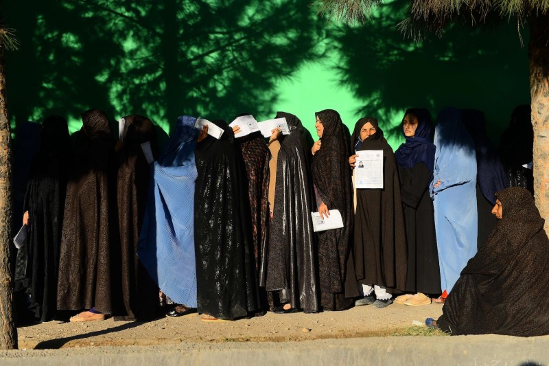 Afghan women wait in line to vote at a polling center for the country's legislative election in Herat province on Oct. 20. (Hoshang Hashimi/AFP/Getty Images)