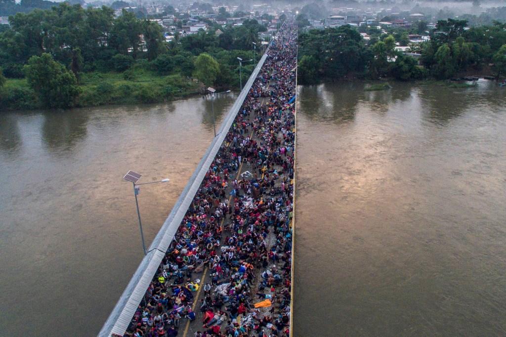 A Honduran migrant caravan crowds the Guatemala-Mexico international border bridge in Ciudad Hidalgo, in Chiapas state, Mexico, on Oct. 20. (Pedro Pardo/AFP/Getty Images)