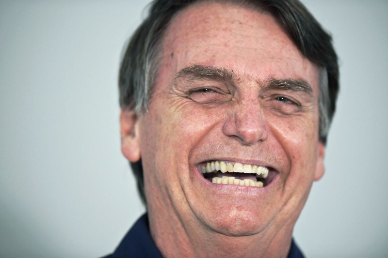 Brazilian far-right presidential candidate Jair Bolsonaro talks to the press in Rio de Janeiro on Oct. 25. (Carl de Souza/AFP/Getty Images)