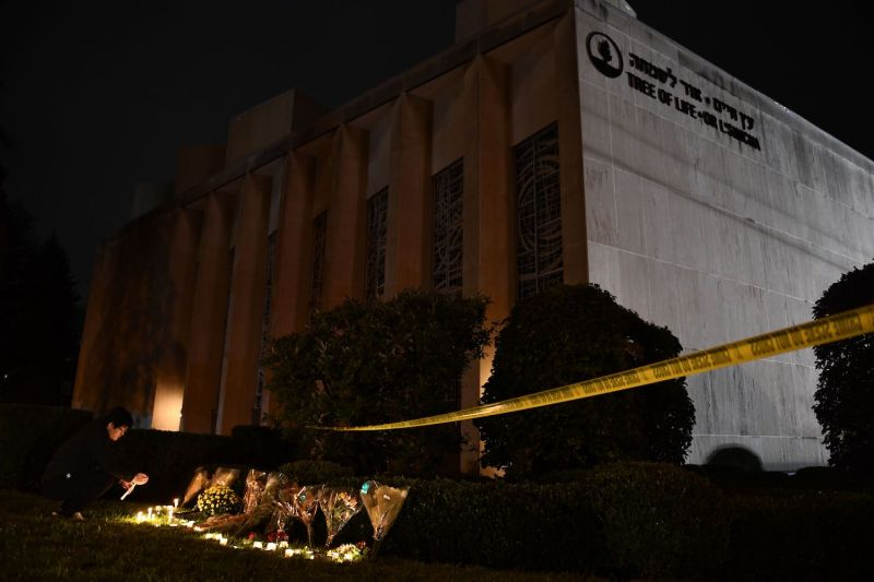 A man lights a candle outside of the Tree of Life Synagogue in Pittsburgh on Oct. 27. (Brendan Smialowski/AFP/Getty Images)