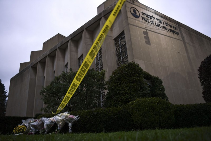 Police tape and memorial flowers are seen on October 28, 2018 outside the Tree of Life Synagogue after a shooting there left 11 people dead in the Squirrel Hill neighborhood of Pittsburgh on October 27, 2018. BRENDAN SMIALOWSKI/AFP/Getty Images