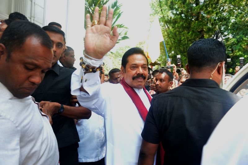 Sri Lanka's newly appointed prime minister, Mahinda Rajapaksa, waves to supporters in Colombo on Oct. 29. (Ishara S. Kodikara/AFP/Getty Images)