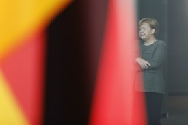 German Chancellor Angela Merkel stands in a courtyard after the weekly government cabinet meeting in Berlin on Oct. 31.