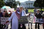 A protester dressed as Saudi Arabian crown prince Mohammed bin Salman and another dressed as U.S. President Donald Trump demonstrate outside the White House in Washington on Oct. 19. (Win McNamee/Getty Images)