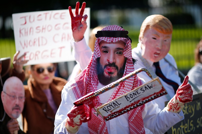 A protester dressed as Saudi Crown Prince Mohammad bin Salman and another dressed as U.S. President Donald Trump stand outside the White House in the wake of the disappearance of the Saudi journalist Jamal Khashoggi on Oct. 19. (Win McNamee/Getty Images)