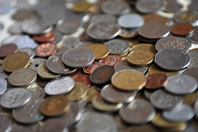 A collection of coins from all over the world is pictured in Milan, Italy, on Dec. 9, 2011. (Giuseppe Cacace/AFP/Getty Images)