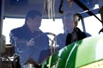 Then Chinese Vice President Xi Jinping (L) talks with Rick Kimberley as they sit in the cab of a tractor while touring his family farm on February 16, 2012 in Maxwell, Iowa.       (Charlie Neibergall/AFP/Getty Images)