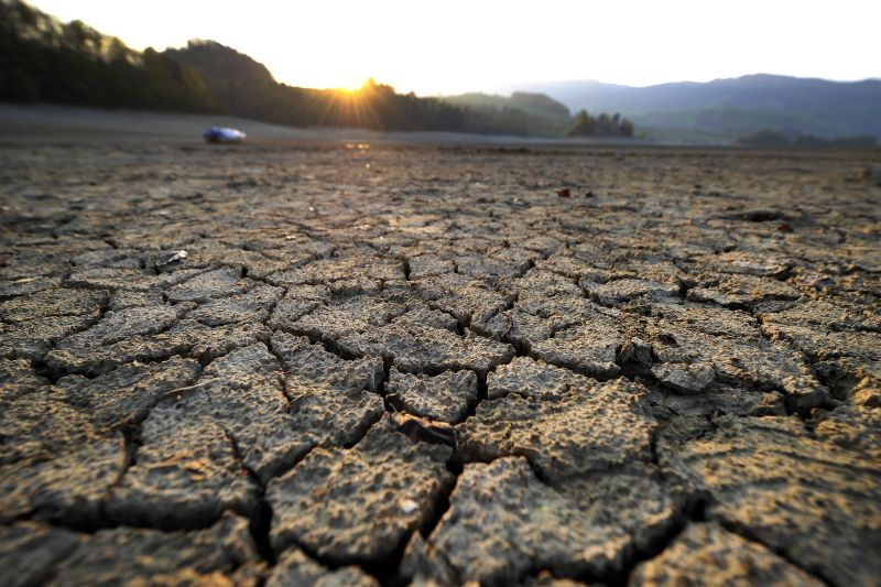 Cracked mud is pictured at sunrise on the dried shores of Lake Gruyère, affected by continuous drought, near the western Swiss village of Avry-devant-Pont. (Fabrice Cofrin/AFP/Getty Images)