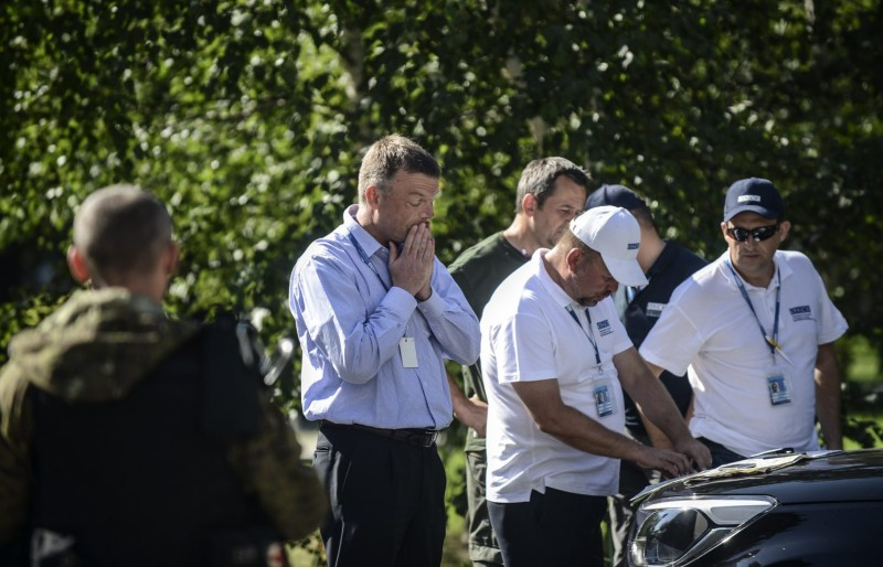Deputy Chief Monitor of the Organization for Security and Cooperation in Europe (OSCE) Special Monitoring Mission to Ukraine, Alexander Hug (2nd L), reacts as fellow OSCE members (R) look on during a meeting with separatists in Donetsk on July 30, 2014. Bulent Kilic/AFP/Getty Images)