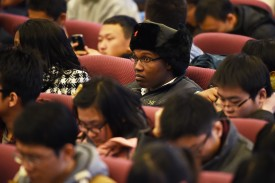 A South African student waits for the arrival of South African President Jacob Zuma for a speech at Tsinghua University in Beijing on Dec. 5, 2014. (Greg Baker/AFP/Getty Images)