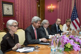 Wendy Sherman, the U.S. undersecretary of state for political affairs, sits next to (from left) U.S. Secretary of State John Kerry, U.S. Energy Secretary Ernest Moniz, Robert Malley from the U.S. National Security Council, and European Union representative Helga Schmid during a negotiation session with Iranian Foreign Minister Mohammad Javad Zarif over Iran's nuclear program in Lausanne, Switzerland, on March 20, 2015. (Brian Snyder/AFP/Getty Images)