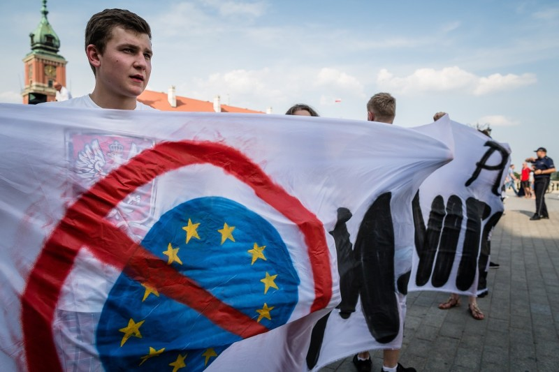 Far-right protesters in Poland hold an anti-EU banner during a demonstration in Warsaw on a Jul. 25, 2015. (Wojtek Radwanski/AFP/Getty Images)