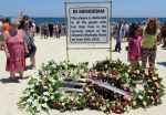 Tourists and Tunisians take part in a ceremony on July 3, 2015, in memory of those killed the previous week by a jihadist gunman in front of the Riu Imperial Marhaba Hotel, on the outskirts of Sousse south of the capital Tunis. (Fethi Belaid/AFP/Getty Images)