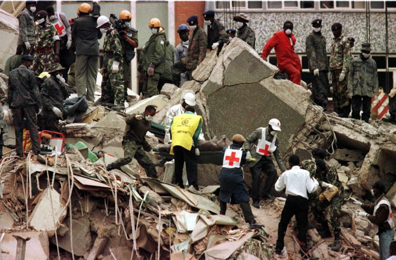 Rescue workers carry a body on Aug. 9, 1998, in the aftermath of a bombing two days earlier that targeted the U.S. Embassy in Nairobi. (AFP/Getty Images)