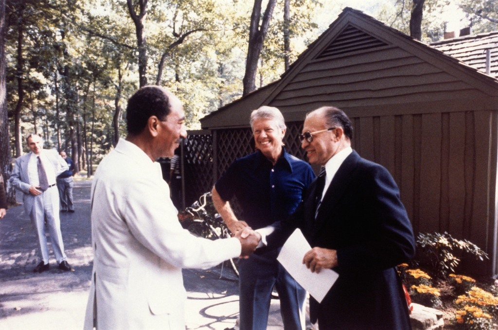 Israeli Prime Minister Menachem Begin shakes hands with Egyptian President Anwar Sadat at the start of the second trilateral meeting with U.S. President Jimmy Carter at Camp David on Sept. 7, 1978. The talks led to the Camp David Accords.(Bettmann Archives via Getty Images)