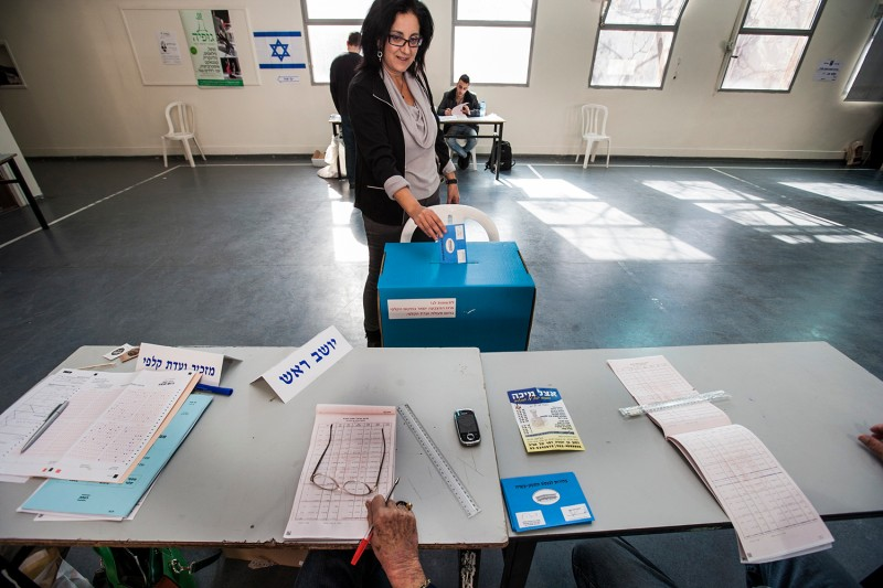 A woman votes in Tel Aviv, Israel, in 2013. (NurPhoto via Getty Images)