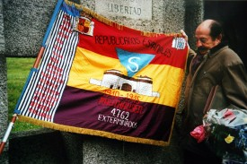Enric Marco stands beside a Spanish Republican flag at Mauthausen, a concentration camp in Austria, in May 2003. (Lluis Gene/AFP/Getty Images)