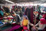 HA GIANG, VIETNAM - November 27, 2016: Local people mostly H'mong go shopping for clothes at Dong Van Sunday Market, in the mountainous border province of Ha Giang. (Photo by Linh Pham/Getty Images)