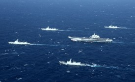 This aerial photo taken on Jan. 2, 2017, shows a Chinese navy formation, including the aircraft carrier Liaoning (C), during military drills in the South China Sea. (STR/AFP/Getty Images)