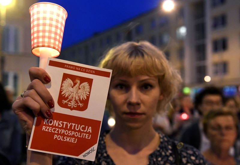 A woman holds a candle as protesters take part in a demonstration in front of the Polish Supreme Court on July 23, 2017, in Warsaw to protest against a new bill changing the judiciary system. (Janek Skarnyzski/AFP/Getty Images)