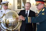 Russian Navy Commander in Chief Adm. Vladimir Korolyov, President Vladimir Putin, and Defense Minister Gen. Sergei Shoigu examine a globe in St. Petersburg on July 30, 2017. (Alexey Nikolsky/AFP/Getty Images)