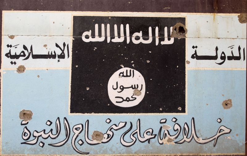 A picture shows a mural depicting the emblem of the Islamic State in Hawija, Iraq, on Oct. 5, 2017. (Ahmad al-Rubaye/AFP/Getty Images)