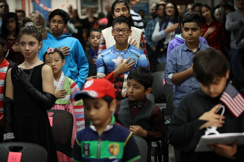 A Halloween-themed citizenship ceremony for children at U.S. Citizenship and Immigration Services in Washington, D.C., on Oct. 31, 2017. (Photo by Drew Angerer/ Getty Images).