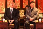 U.S. President Donald Trump looks up as he sits beside Chinese President Xi Jinping during a tour of the Forbidden City in Beijing on November 8, 2017. (Jim Watson/AFP/Getty Images)