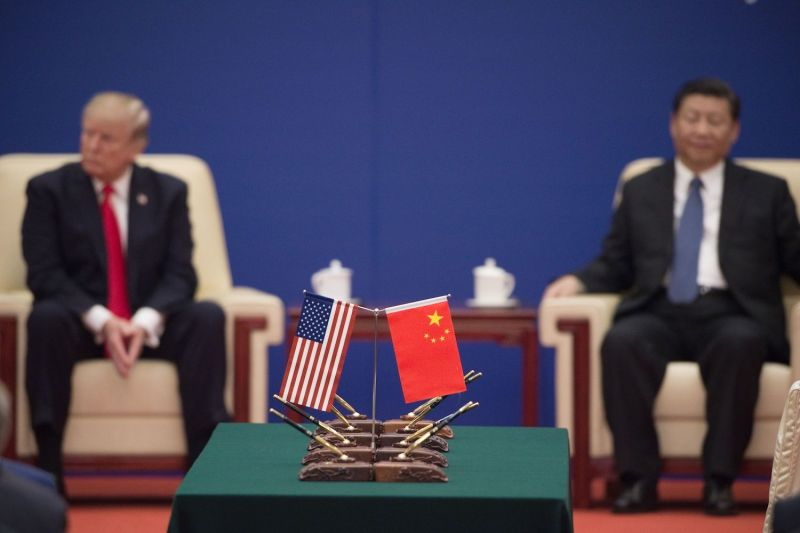 U.S. President Donald Trump and Chinese President Xi Jinping attend an event for business leaders in Beijing on Nov. 9, 2017. (Nicolas Asfouri/AFP/Getty Images)