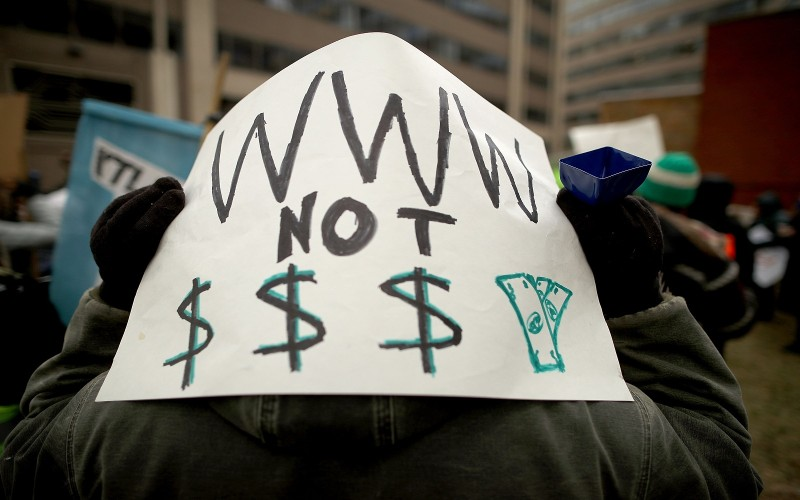 Demonstrators rally outside the Federal Communications Commission building to protest against the end of net neutrality rules in Washington on Dec. 14, 2017. (Chip Somodevilla/Getty Images)