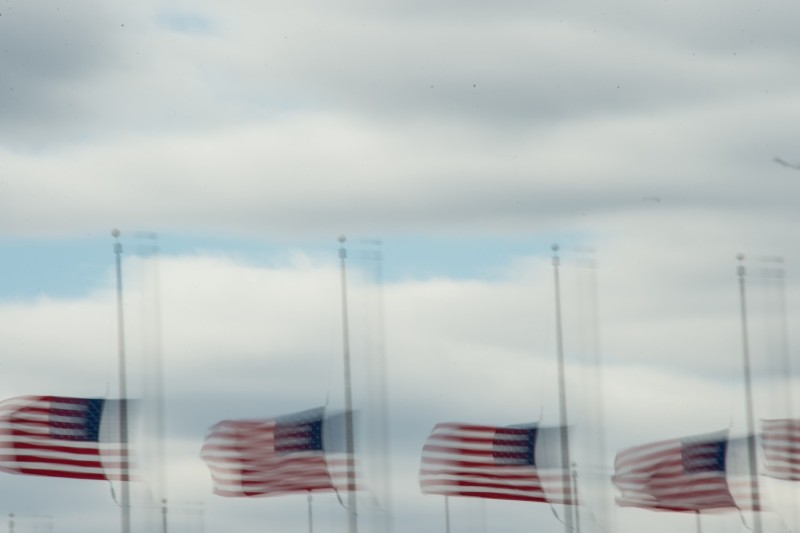 U.S. flags flutter in strong wind in front of the Washington Monument in Washington, D.C., on March 2. (Nicholas Kamm/AFP/Getty Images)