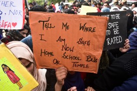 A Kashmiri student holds a placard during a protest rally against the rape and murder of 8-year-old Asifa Bano in Srinagar, Indian-administered Kashmir, on April 16. (Saqib Majeed/SOPA Images/LightRocket via Getty Images)