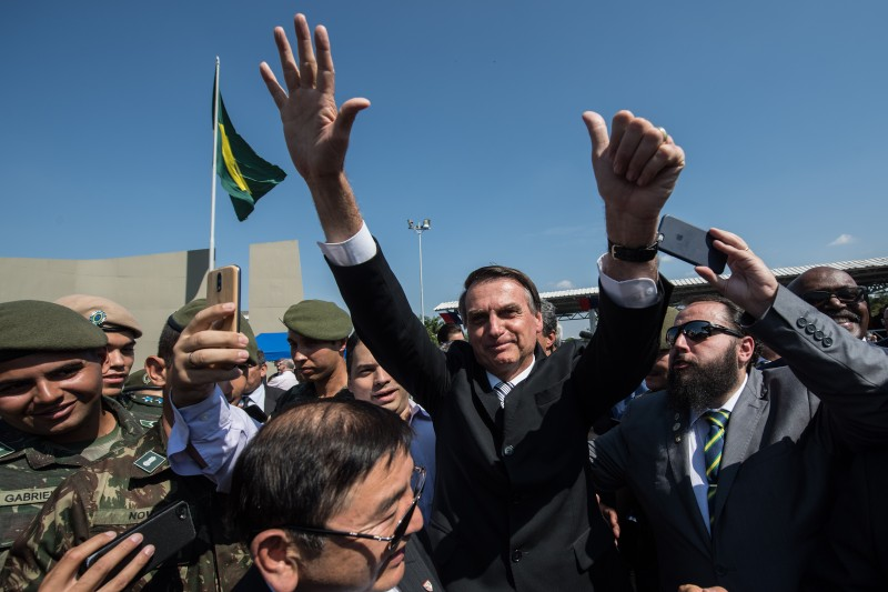 Jair Bolsonaro waves to the crowd during a military event in São Paulo on May 3. (Nelson Almeida/AFP/Getty Images)