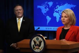 U.S. Secretary of State Mike Pompeo listens as State Department spokesperson Heather Nauert speaks to press at the State Department on May 29. (Alex Wong/Getty Images)