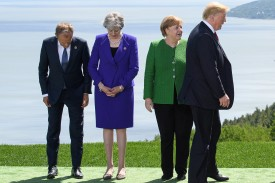 European Council President Donald Tusk (from left), British Prime Minister Theresa May, German Chancellor Angela Merkel, and U.S. President Donald Trump prepare for a photo at the G-7 summit in La Malbaie, Canada, on June 7. (Leon Neal/Getty Images)