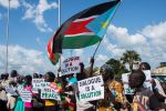 South Sudanese await the arrival of South Sudan's president, Salva Kiir, in Juba after peace talks in Ethiopia on June 22. (Akuot Chol/AFP/Getty Images)