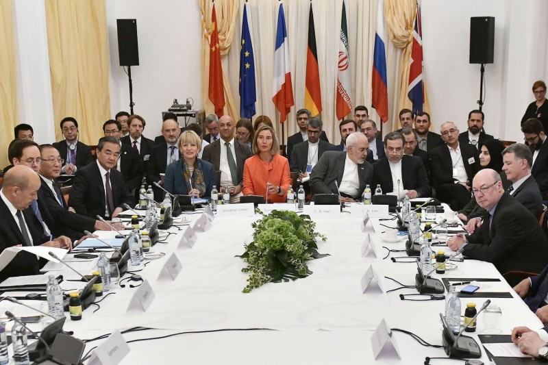 Foreign dignitaries, including European Union foreign-policy chief Federica Mogherini and Iranian Foreign Minister Mohammad Javad Zarif (center), meet in Vienna on July 6. (Hans Punz/AFP/Getty Images)