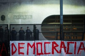 """A sign reading """"democracy"""" is hung in front of the Brazilian Embassy during a protest against Jair Bolsonaro in Buenos Aires on Oct. 30. (Mario De Fina/NurPhoto/Getty Images)"""