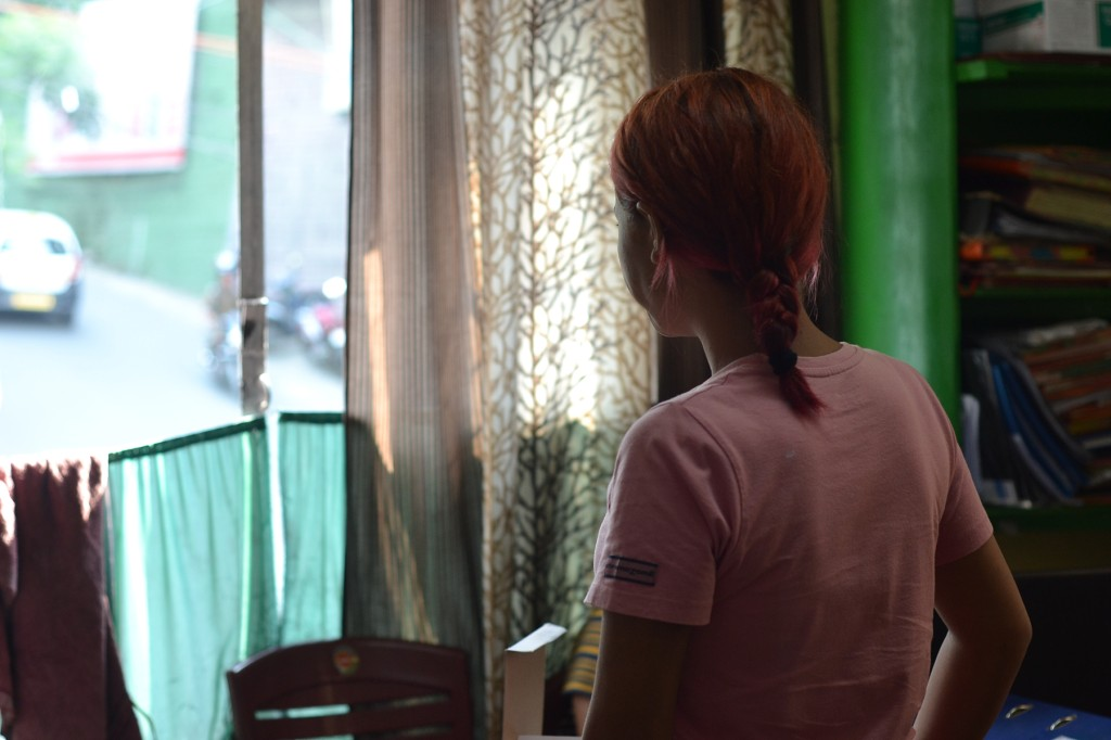 A 26-year-old resident of the Indian state of Mizoram visits the drop-in center for female drug users in Aizawl to collect her daily dose of opioid substitution therapy on May 30. She began using in 2013, which has left her with painful abscesses on both her legs. She is one of many users who claim to have been beaten by Young Mizo Association volunteers on the streets. (Sarita Santoshini for Foreign Policy)