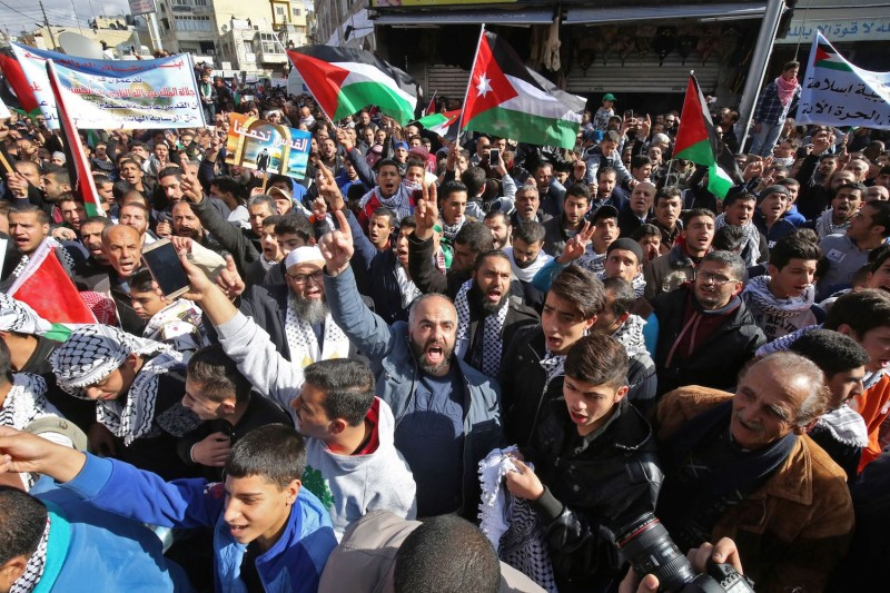 Jordanian protesters wave their national flags and Palestinian flags during a demonstration against the U.S. president's decision to recognize Jerusalem as the capital of Israel, on December 15, 2017, in the Jordanian capital Amman.
