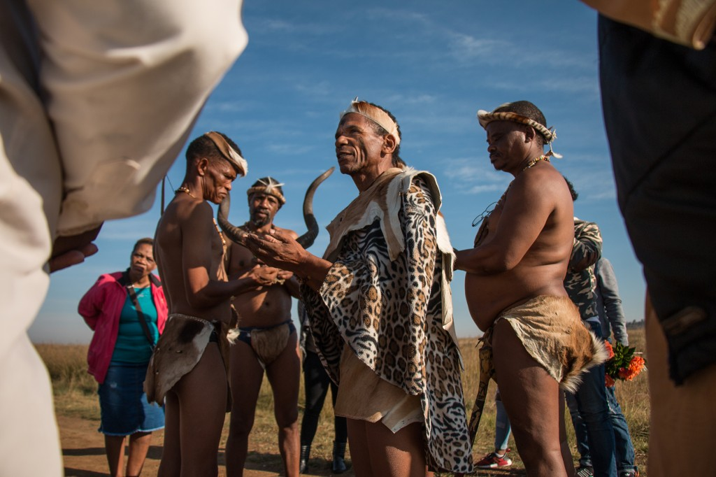 Khoisan elders and activists prepare to honor the Khoisan activist Adam Mathysen at his grave on the outskirts of Johannesburg on April 27. (Nathan Siegel for Foreign Policy)