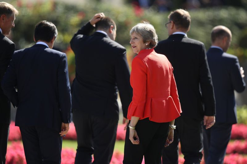 British Prime Minister Theresa May looks back as she and other leaders depart at a summit of leaders of the European Union on September 20, 2018 in Salzburg, Austria.