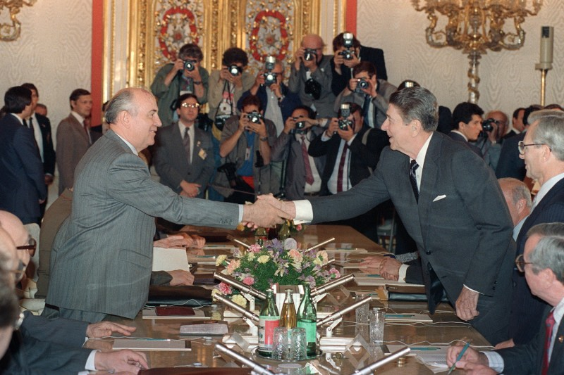U.S. President Ronald Reagan shaking hands with Soviet leader Mikhail Gorbachev at the Kremlin Place prior to their last summit meeting on June 1, 1988.