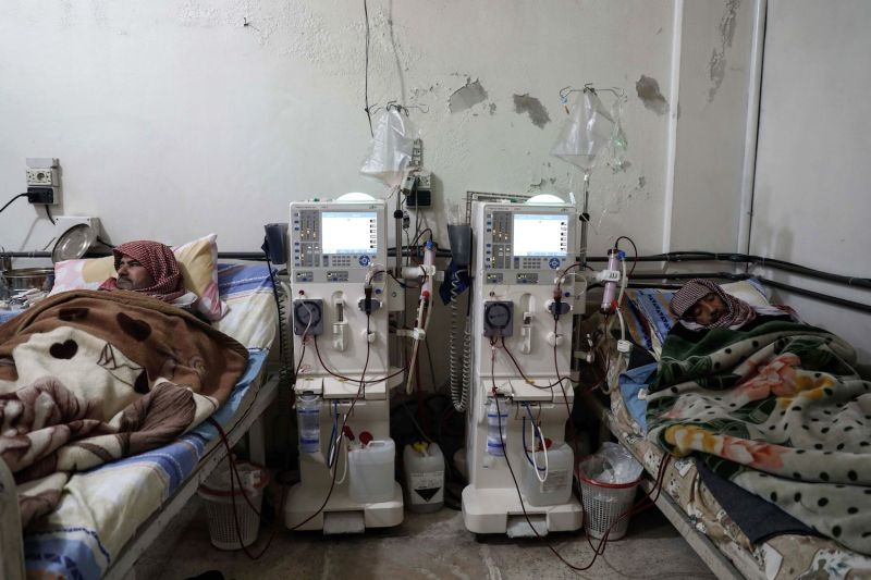 Syrian patients receiving treatment in a basement-turned-clinic in the besieged rebel-held town of Douma, on the outskirts of Damascus, on March 16, 2017.