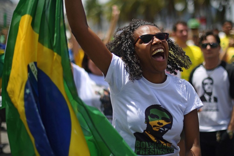 A supporter of Brazil's far-right presidential candidate Jair Bolsonaro takes part in a rally in Rio de Janeiro on Oct. 21. (CARL DE SOUZA/AFP/Getty Images)