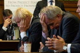 """Conservative members of Parliament Jacob Rees-Mogg, Boris Johnson, and Peter Bone listen during the launch of """"A World Trade Deal: The Complete Guide"""" at the Houses of Parliament on September 11, 2018 in London, England."""