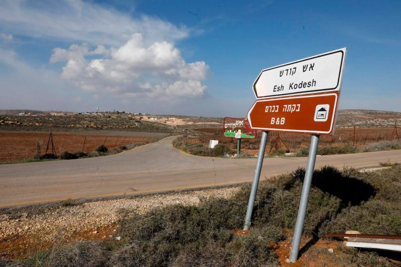A road sign points towards an Airbnb apartment, located in the Esh Kodesh outpost, near the Jewish settlement of Shilo and the Palestinian village of Qusra in the West Bank on November 20, 2018.