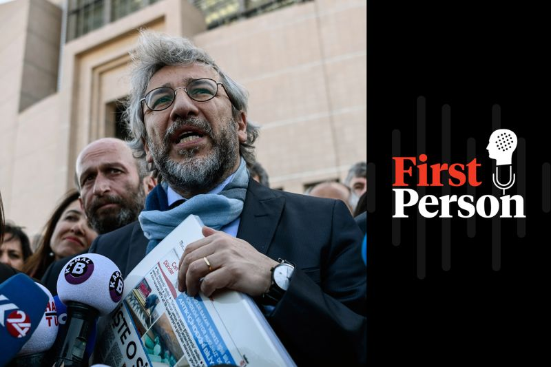 Cumhuriyet editor in chief Can Dundar speaks to media as he arrives at a courthouse for trial in Istanbul on April 1, 2016. (Ozan Kose/AFP/Getty Images)
