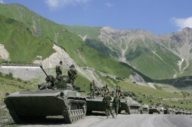 A convoy of Russian troops makes its way through the mountains in the village of Dzhaba on August 9, 2008 as Georgian troops battled with Russian forces over breakaway provinces.